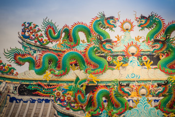 Colorful chinese dragon statues on roof in Chinese temple. Chinese dragons on the roof top of shrine.