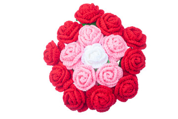 Crochet roses with yarn for giving to those we love, Valentine's day isolated on white background, Top view.