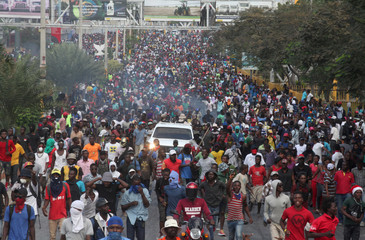 Demonstrators participate in an anti-government protest in Port-au-Prince