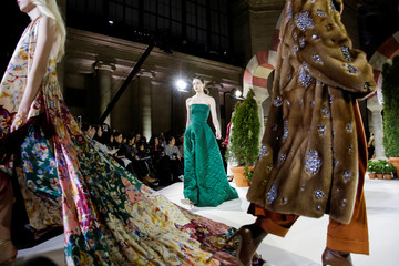 Models present creations from the Oscar de la Renta collection during New York Fashion Week in New York