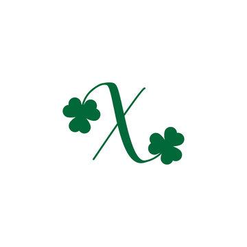initial letter Shamrock leaf