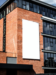 University, company office building facade, Blank white paper board at grunge brick red wall...