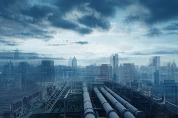 Industry reaching to city concept with pipe line gasoline and abstract city skyline at background in blue tone.