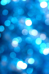 abstract blurred glowing light particles of shades of blue