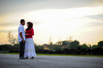 A romatic loving couple at park in Malaysia