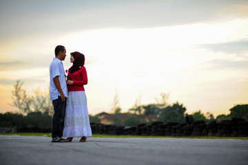 Couple outdoors enjoying a evening day looking happy together. Malay couple in Malaysia