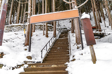 Stairway entrance to see snow monkeys soaked in the onsen at Jigokudani Onsen, Nagano, Japan