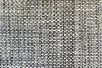genuine factory gray fabric as the background. close up