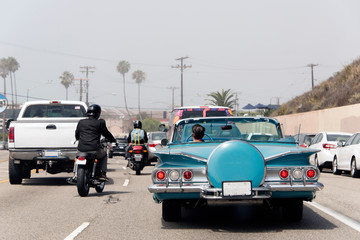 Printed roller blinds Vintage cars A traffic jam in Malibu, California with a vintage convertible car, motorcycle and pick up truck in summer time
