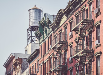 Water tank and fire escapes, symbols of New York City, color toning applied, USA.