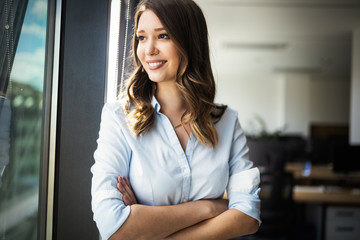 Wall Mural - Successful business woman looking confident and smiling
