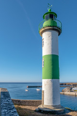 French landscape - Bretagne. Lighthouse in a small fishing village.