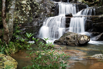 Mountain river background with small waterfalls in tropical forest.