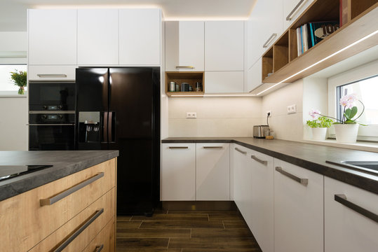 Interior of modern kitchen with built-in appliances