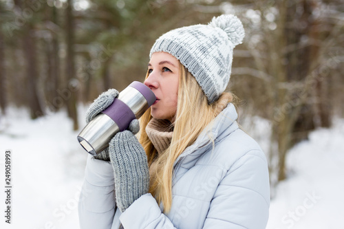 f0e720039 portrait of young blond woman drinking coffee in winter park or ...