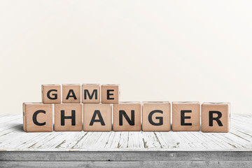 Game changer sign made of wooden blocks