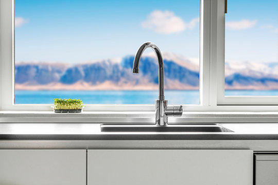 Kitchen sink by a window with a view