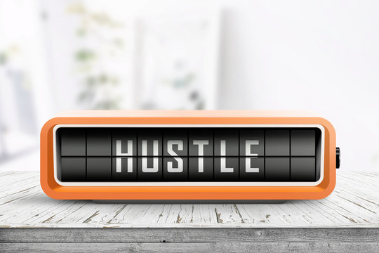 Hustle alarm on a wooden table in a bright room