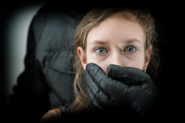 Man's hand covering mouth of scared young girl. Wall mural