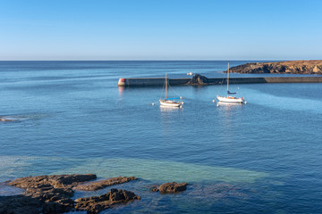 French landscape - Bretagne. Sailing boats in a beautiful bay after sunrise.