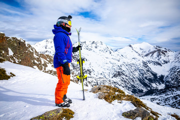 Portrait of a skier in high mountain