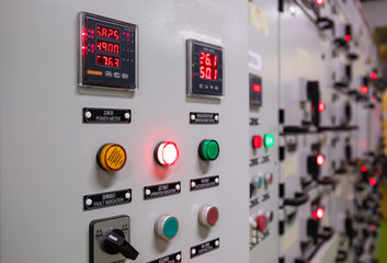 Electrical switch gear at Low Voltage motor control center cabinet  in coal power plant. blurred for background.