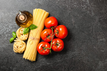 Pasta, tomatoes and olive oil on black