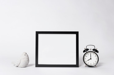 photo frame mock up and clock Interior decor home elements.