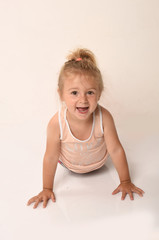 child dancing on white background