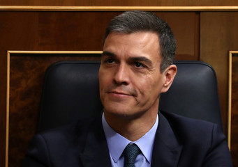 Spain's Prime Minister Pedro Sanchez reacts during a session at Parliament in Madrid