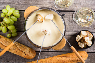 Cheese fondue with bread wine and grape