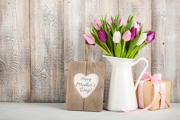 Mother's Day background  with fresh tulips and gift