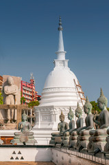 Famous sitting Buddha statues and stupa in the Seema Malaka Temple in Colombo, Sri Lanka. This is situated on Beira Lake and is part of the Gangaramaya Buddhist Temple Complex.