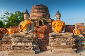 Old Buddha Statues in Wat Yai Chaimongkol Temple, Ayutthaya, UNESCO World Heritage Site, Thailand.