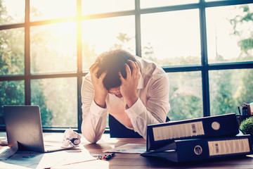 Businessmen are stressed with work in the office.