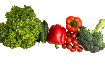 Close up, flat lay. Red and green fresh vegetables on a white background. Copy space.