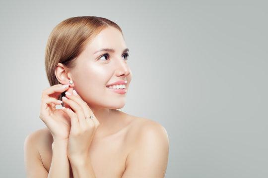 Glamourous jewelry model. Beautiful woman in diamond earrings and ring, fashion beauty portrait