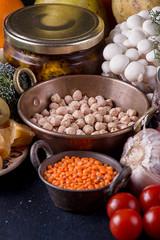 Still life food set on dark background. Concept shealthy eating. Lentils, nut, cheese, garlic, mushrooms, cherry tomato.