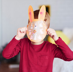 Boy showing handmade greeting card for Easter