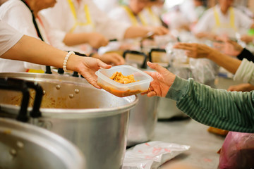 Hands holding food: Hunger problems are assisted by people in society.