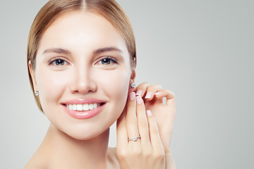 Beautiful girl with jewelry. Set of diamond jewelry for woman, earrings and ring. Beauty and accessories