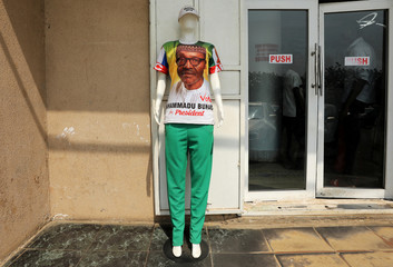 A T-shirt depicting Nigeria's President Muhammadu Buhari is displayed on a mannequin at a shopping centre in Abuja