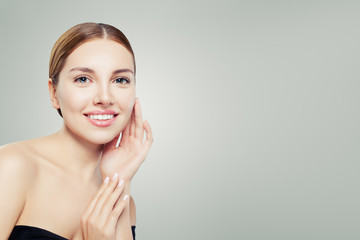 Smiling girl with healthy clear skin. Facial treatment, skincare and cosmetology concept.