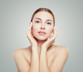 Beautiful woman with young healthy skin. Facial treatment, face lifting,   anti aging and skin care concept.