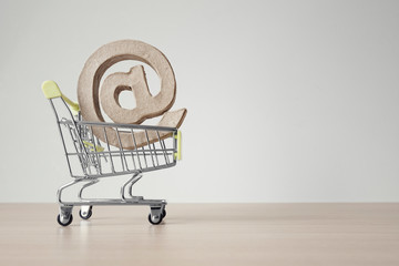 Shopping cart with e-mail at symbol