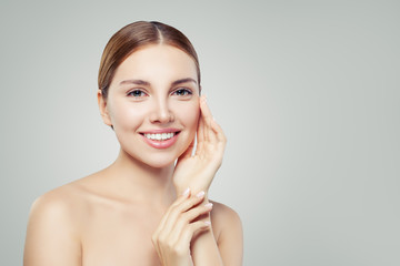 Young woman face. Perfect girl with healthy skin. Healthcare and spa concept.