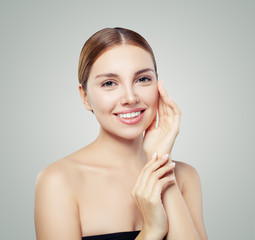 Young smiling woman. Perfect girl with clear skin and cute smile. Skincare and cosmetology concept.