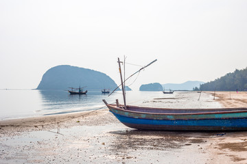 Wooden fishing boats on a tropical beach.