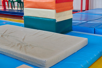 hall for gymnastics at school. multi-colored mats. doing sports. sports equipment. healthy lifestyle. sport competitions
