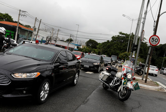 A convoy of vehicles transporting Brazil's President Jair Bolsonaro is seen near the Congonhas airport after leaving the Albert Einstein Hospital in Sao Paulo